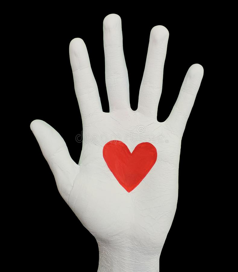 White Hand With Beating Heart stock photo