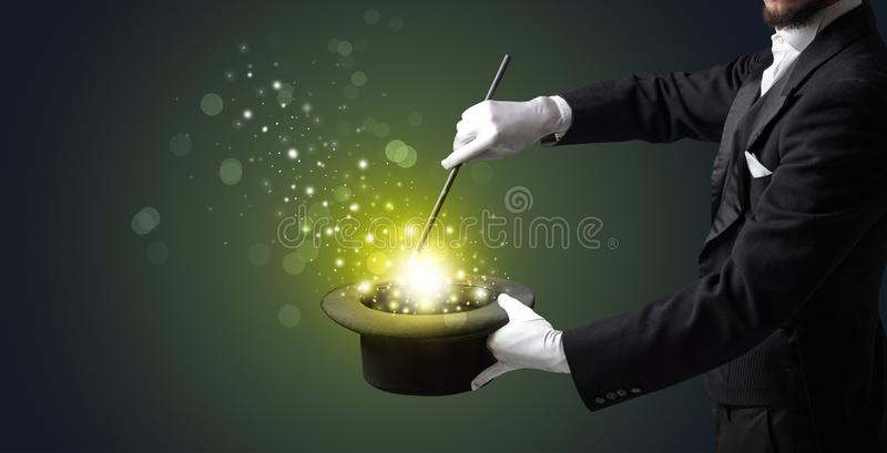 White hand in middle of conjuring. White glove hand conjuring something mysterious stock image