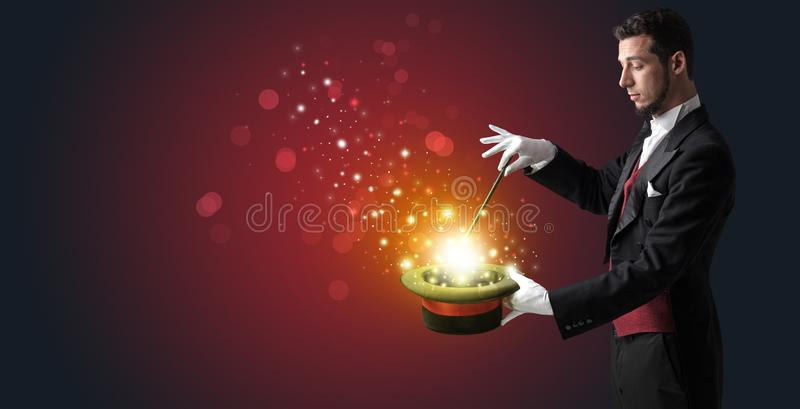 White hand in middle of conjuring. White glove hand conjuring something mysterious royalty free stock photos