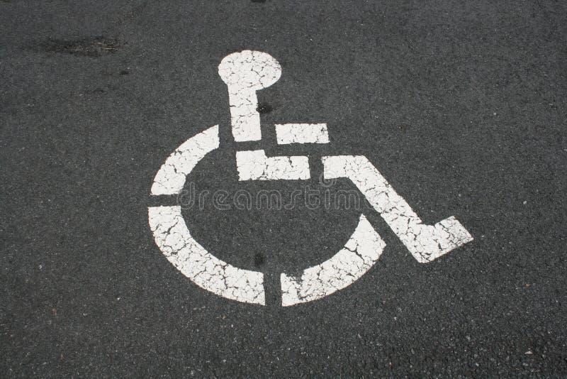 White Handicapped Symbol On Pavement Stock Image