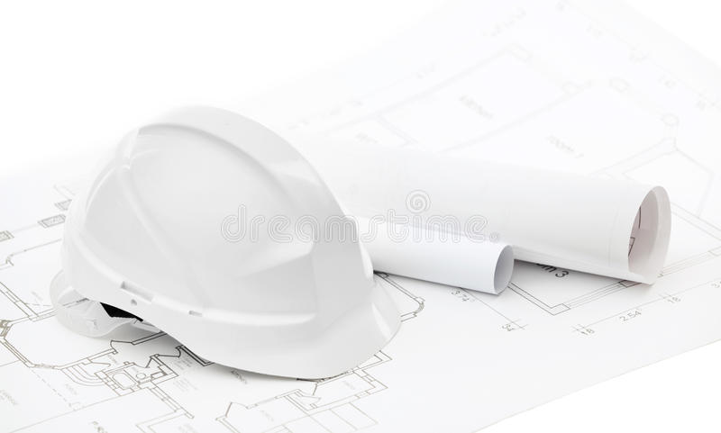 Download White Hard Hat Near Working Drawings Stock Photo - Image: 27001404