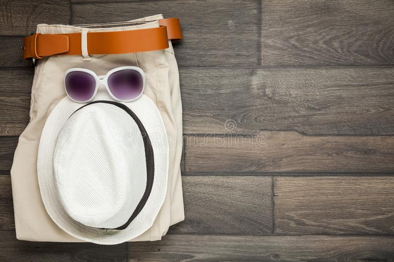 White hat and trousers are. On the wooden background stock image