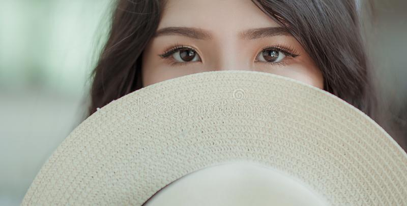 White Hat in Woman's Face stock photography