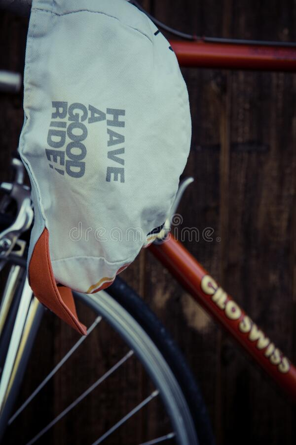 White Have a Good Ride Cap on Red Cilo Swiss Bicycle Frame stock photo