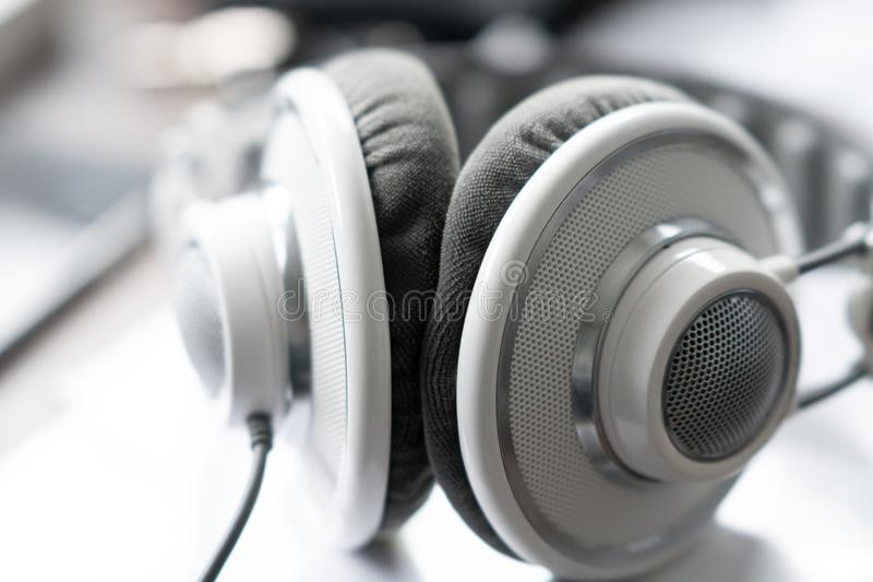 White headphone is lying on the table in bright back light royalty free stock photo