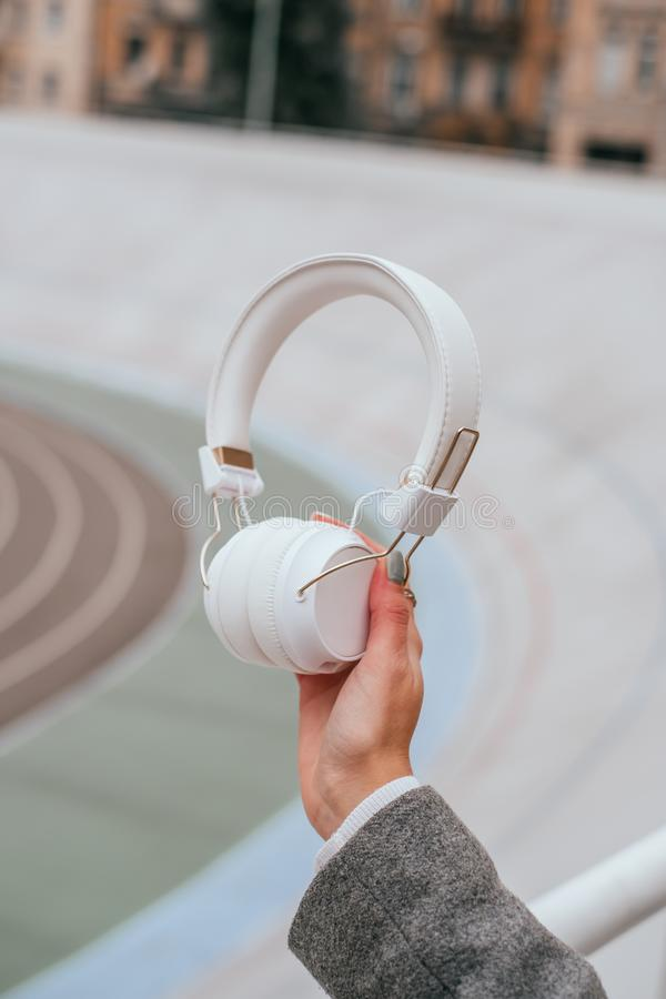 White headphones in the hand royalty free stock image