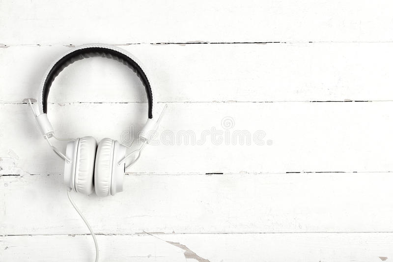 White headphones with wire on white background royalty free stock photos