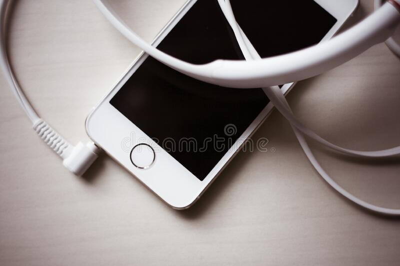 White Headset Connected On Gold Iphone 5s Free Public Domain Cc0 Image