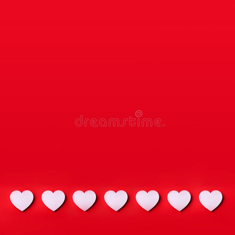 White heart cutted from paper over red background with copy space. Top view. Valentine's Day. Love, date, romantic concept. Squar. E crop royalty free stock photo