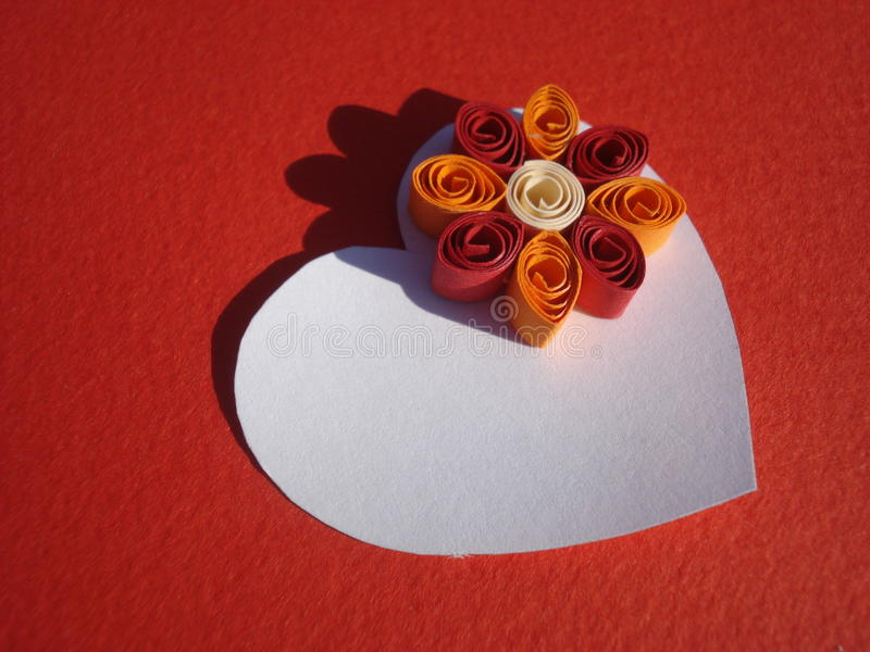White heart with quilling flower on red background royalty free stock images