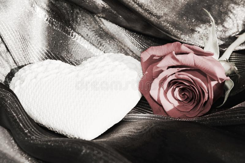 White heart and red rose, vintage hues, background stock photo