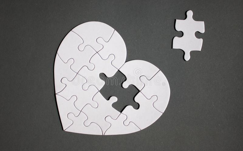 White heart shaped puzzle with missing part royalty free stock image