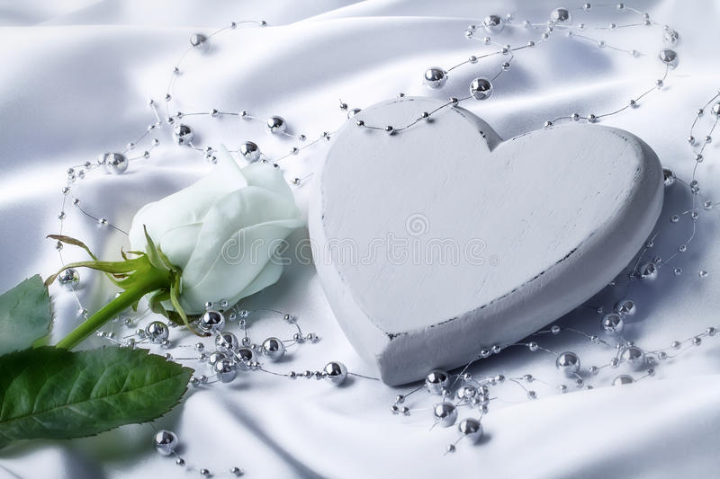 White heart with white rose royalty free stock photo