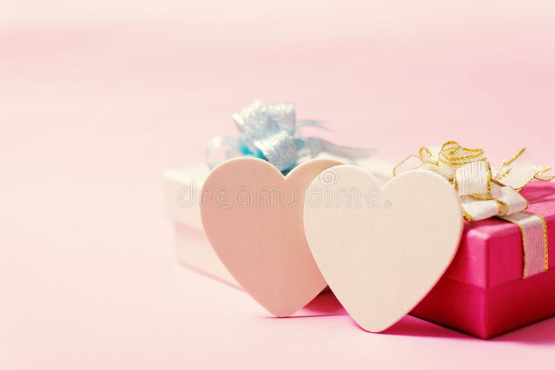 White hearts and gift box on pink background royalty free stock image