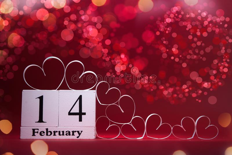 White Hearts and wooden block calendar on red background. Valentines day card. Copy space for your text. stock photography