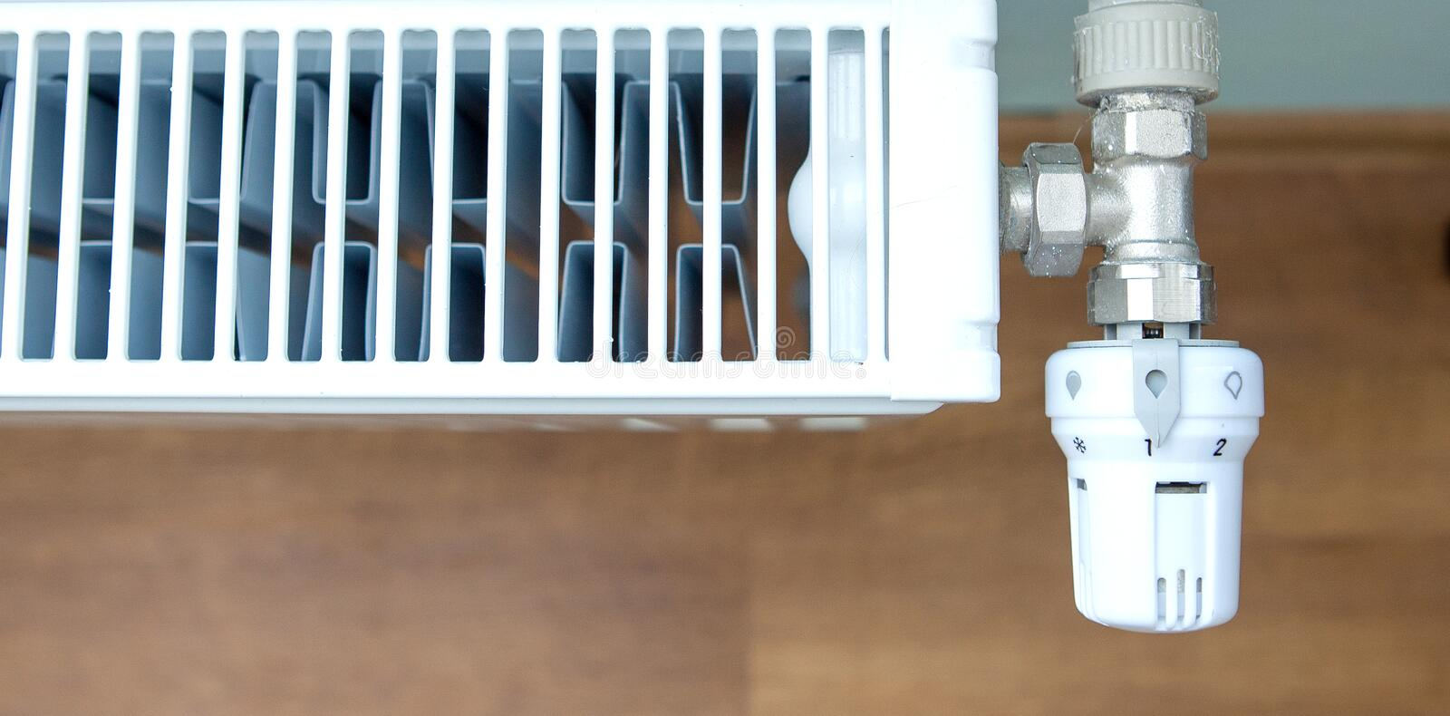 A white heating radiator on the interior wall royalty free stock photos