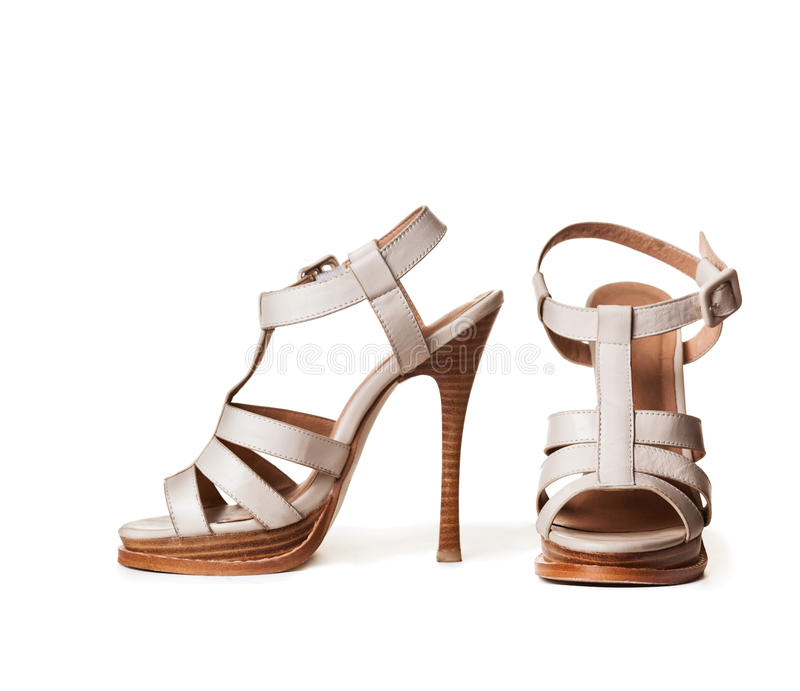 White high-heeled shoes stock photos