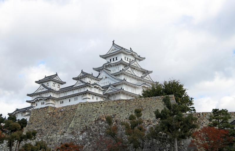 White Himeji Castle on white cloud sky background. Himeji Castle also known as White Heron Castle . stock photography
