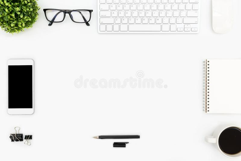 White hipster office desk table with computer gadgets, and supplies. Top view with copy space, flat lay royalty free stock photography
