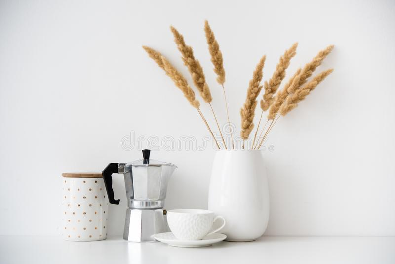 White home decor, coffee maker, ceramic vase and cup on tabletop, contemporary interior stock photos