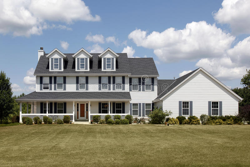 White home with large front yard. Suburban home with large front yard and porch stock photography
