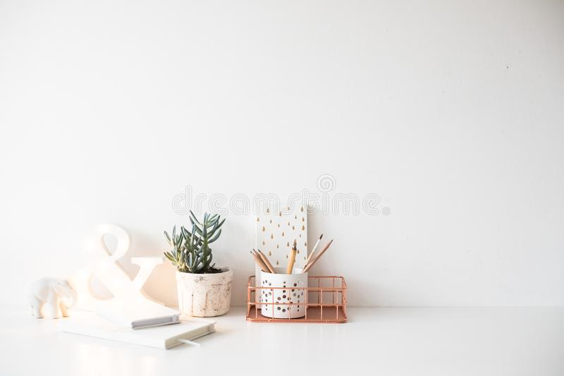White home office table, cozy and nice workplace with notepads a stock photo