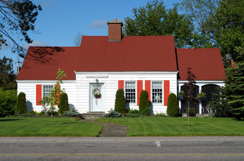 White Home With Red Roof stock image