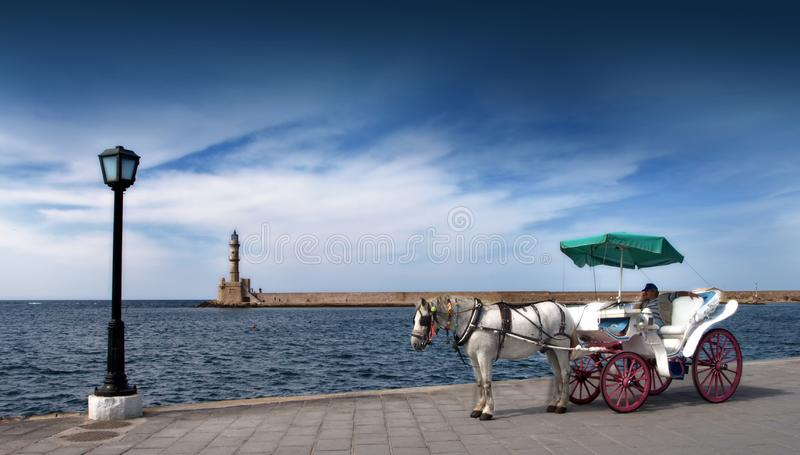 A white horse & Cart on the 14th Century Venetian harbour in Chania Crete royalty free stock photos