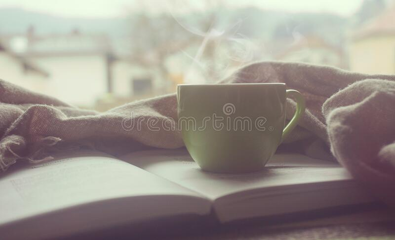 White Hot Mug on Book Near Linen royalty free stock photo