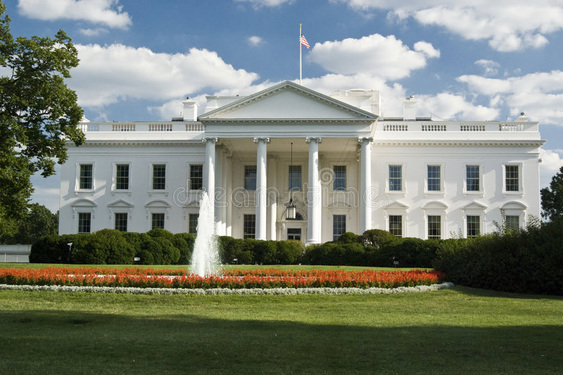 The White House. With fountain, perfect grass garden and sunning blue sky with clouds - Washington DC 2007 stock photos