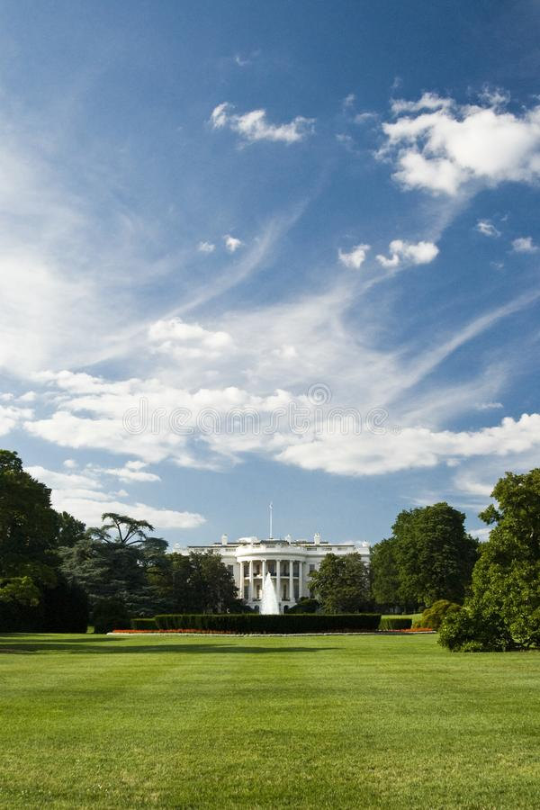 The White House. With fountain, perfect grass garden and sunning blue sky with clouds - Washington DC 2007 stock photography