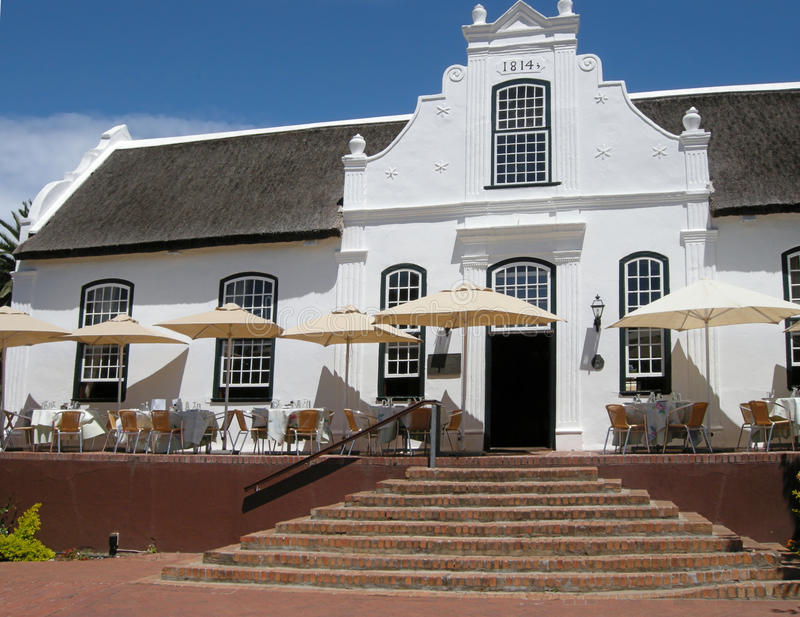 White house in colonial style on wine farm, Stellenbosch, South Africa. STELLENBOSCH, SOUTH AFRICA - JANUARY 1, 2008: White house in colonial style on wine farm stock photo
