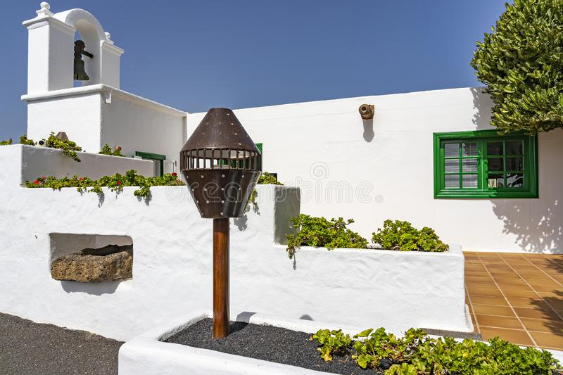 This white house, contrasting sharply with the deep blue of the sky, on the island of Lanzarote, Spain.  stock image