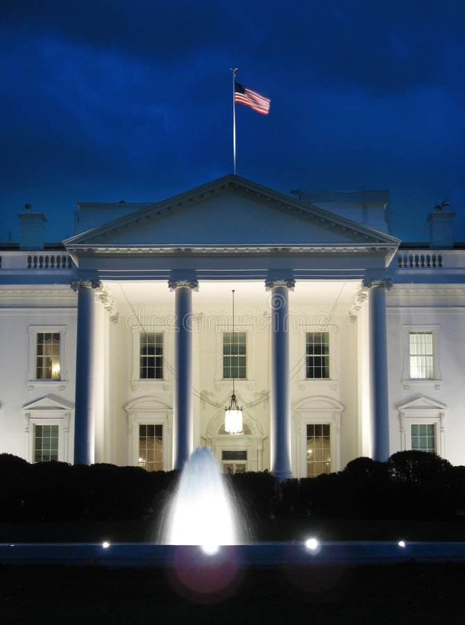 White House and Fountain. Photo of the White House in Washington D.C. during night. This landmark is one of the most popular tourist attractions in the world