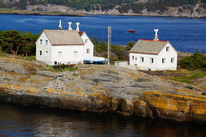 White house on island, Langesund, Norway. Langoytangen Fyr, Bamble (Langesund lighthouse houses). View from the norwegian cruise ship sailing in the North Sea stock photos
