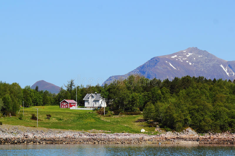 White house and red cabin of Meloey. Whithe house and red cabin of an island Norwegian polar circle stock photos