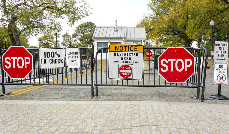 White house stop signal. Washington, DC, USA, october 30, 2016: A road block stop sign at the entrance of the White House in Washington DC stock photo
