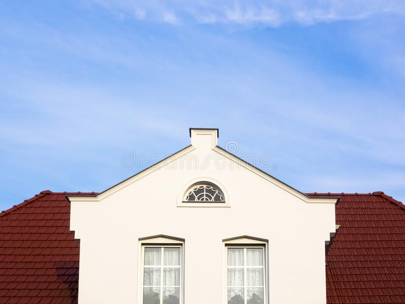 White house with three-level gable and copy space.  royalty free stock photo