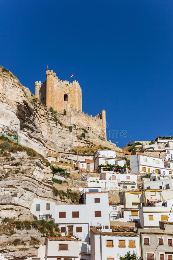 White houses and castle tower of Alcala del Jucar. Spain stock photo
