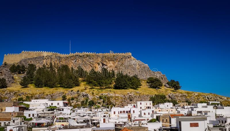 The white houses in the historic village and the acropolis in the top of the mountain. view from terrace royalty free stock photo