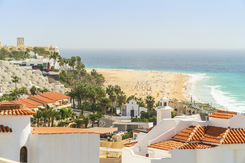 White houses nad resorts by wide sandy beaches in Morro Jable on Fuerteventura, Spain. White houses nad resorts by wide sandy beaches in Morro Jable, Jandia royalty free stock photo
