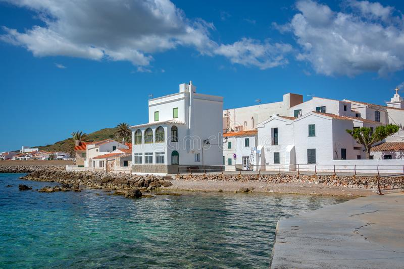 White houses by the sea in the villlage of Fornells, Balearic islands Spain. White houses by the sea in the villlage of Fornells, Balearic islands, Spain stock photo