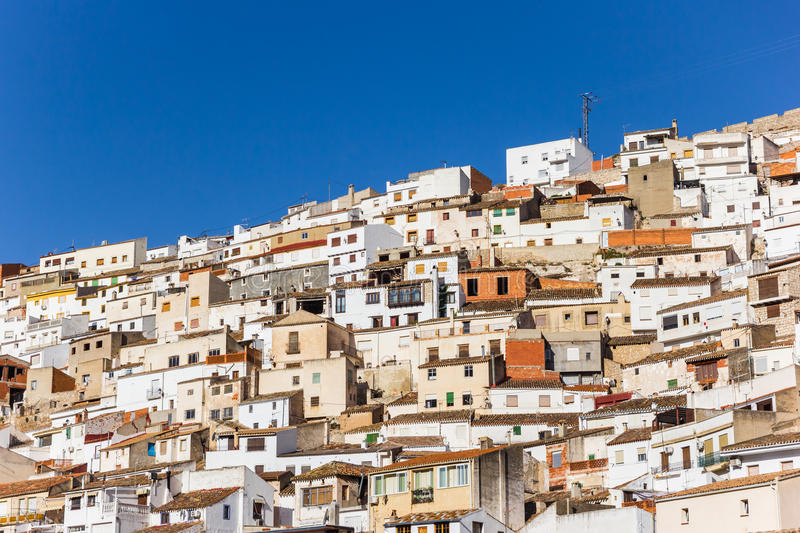 White houses on the steep hill of Alcala del Jucar. Spain royalty free stock photo