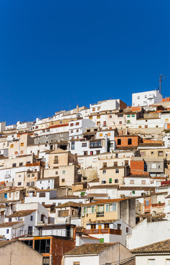 White houses on the steep hill of Alcala del Jucar. Spain royalty free stock image