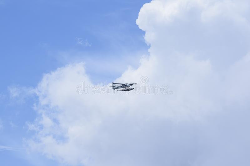 White Hydroplane Flying on the Sky royalty free stock image