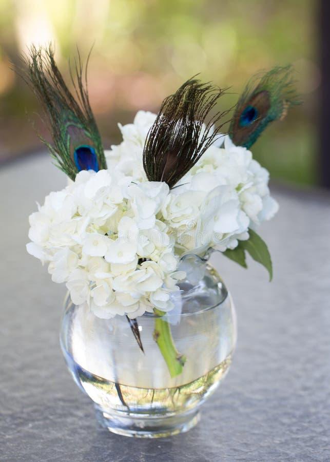 White Hyndrangea and Peacock Feather Centerpiece stock photos