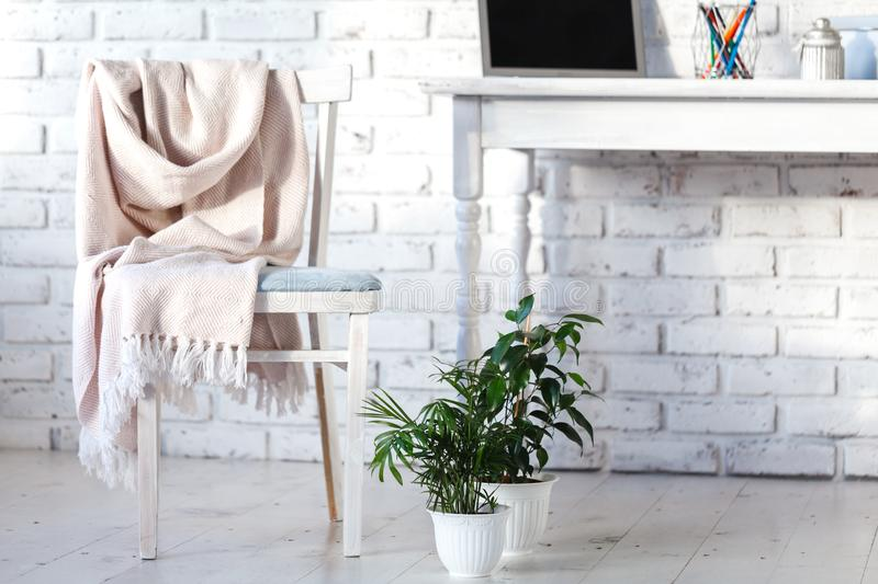 White interior with chair, rug and small table stock image
