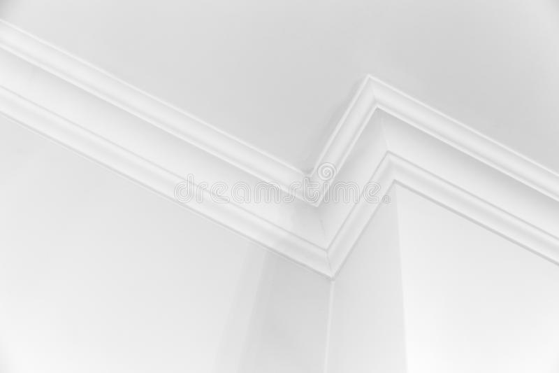 White interior with corner and ceiling baseboard. White interior fragment with corner and decorative ceiling baseboard stock image