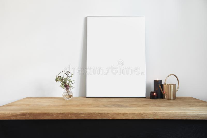 White interior with wooden table, big poster, space for design layout. royalty free stock photos