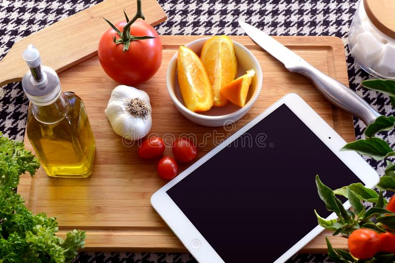 White Ipad Near Bowl With Orange royalty free stock image